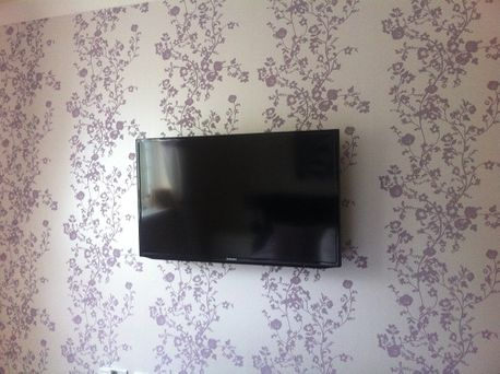tv installation on a wall